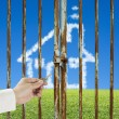 Stock Photo: Unlocking locked door with cloud house, meadow and blue sky