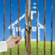 Unlocking locked door with cloud house, meadow and blue sky — Stock Photo