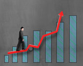 Businessman walking on growth red arrow with chart — Stock Photo