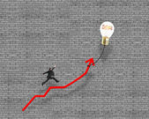 Businessman jumping on growth red arrow with glowing lamp balloo — Stock Photo