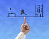 Office and home on seesaw drawing with one businessman running — Stock Photo