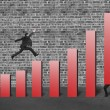 Businessman lift one red bar and another jumping on chart — Stock Photo #36906555