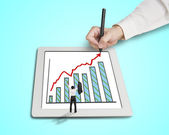Hand drawing growth arrow, chart on tablet with cheered busines — Stock Photo