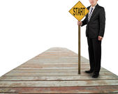 "Businessman hold board with word ""start"" standing on wooden way — Stock Photo"
