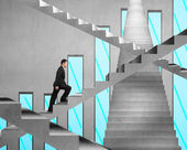 Businessman climbing on concrete stair with chart on concrete wa — Stock Photo