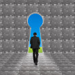 Businessman walking toward key shape door on puzzles wall — Stock Photo