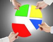 Vier cirkeldiagram stukken houden — Stockfoto