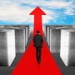 Businessman walking on growing red arrow through 3d Maze — Stock Photo #42341707