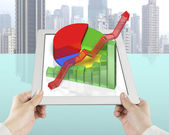 hand holding tablet with 3D chart — Stock Photo