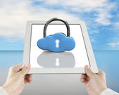 Cloud shape lock on tablet with hand holding — Stock Photo