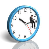Businessman sitting on clock hand — Stock Photo