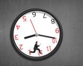 Running inside clock on wall — Stock Photo