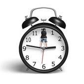 Standing on hands of alarm clock  — Stock Photo