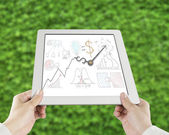 Statistics doodles with clock hands on tablet — Stock Photo