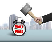 Using hammer hit clock with work face — Stock Photo