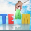 Assembling TEAM 3D word on table with sky reflection — Stock Photo