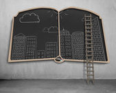 City view doodles on book shape blackboard — Stock Photo