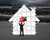 Put red puzzle into house shape for bad situation — Stock Photo