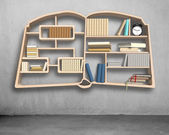 Book shape bookshelf on concrete wall — Stok fotoğraf