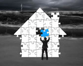 Assembling puzzles in house shape with storm  — Stock Photo