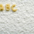 Eatable alphabet on flour, education — Stock Photo