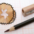 Wooden sharpener, shaving and pencil for plotting — Stock Photo