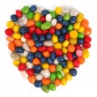 Heart made of multi-coloured sweets with raisin 1 — Stock Photo