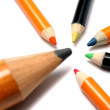 The big pencil and five small color pencils on a diagonal - Stock Photo
