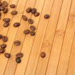 Grains of coffee on a carpet made of a tree  — Stock Photo