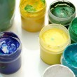 Jars with multi-coloured gouache — Stock Photo