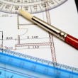 Measuring rulers and art brush on paper with plan — Stockfoto #14116227
