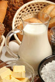 Jug of milk, butter and flour — Stock Photo
