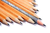 Celebratory pencil among usual pencils on a diagonal — Stok fotoğraf