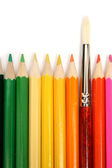 Colour wooden pencils around of an art brush — Stock Photo