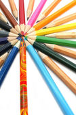 Color pencils have settled down around of the colour leader — Stock Photo