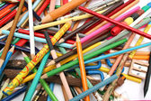 Collection of multi-colour pencils and wooden sharpener — Stock Photo
