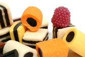 Set of fruit sweets in the form of beaters of various color — Stock Photo