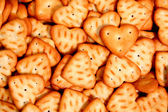 Heart made of a cracker on a background of others cookies 2 — Stock Photo