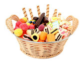 Basket with various sweets and the cookies, isolated — Stock Photo