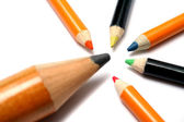 The big pencil and five small color pencils on a diagonal — Stock Photo