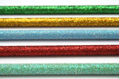 Five celebratory color pencils with a sparkling covering macro — Stock Photo