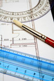 Measuring rulers and art brush on a paper with the plan — Stock Photo
