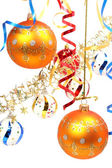Two yellow New Year's spheres on a background of a tinsel — Stock Photo