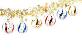 Christmas ornaments in the form of spheres and a tinsel — Stock Photo