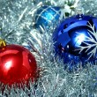 Two New Year's glass spheres of blue and red color — Stock Photo
