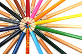 Color pencils have settled down around of the leader — Stock Photo