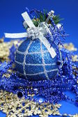 Christmas sphere of dark blue color with a pattern — Stock Photo