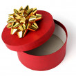 Stock Photo: Gift box of red color with golden bow
