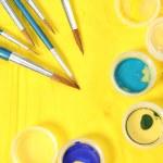 Set of new brushes on a yellow napkin — Stock Photo