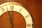 Fragment of a dial with arrows of ancient clocks — Stock Photo